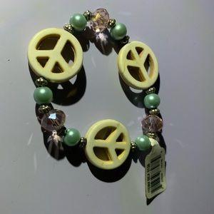 🗯3/$12 ! Yellow green Nicole peace bracelet